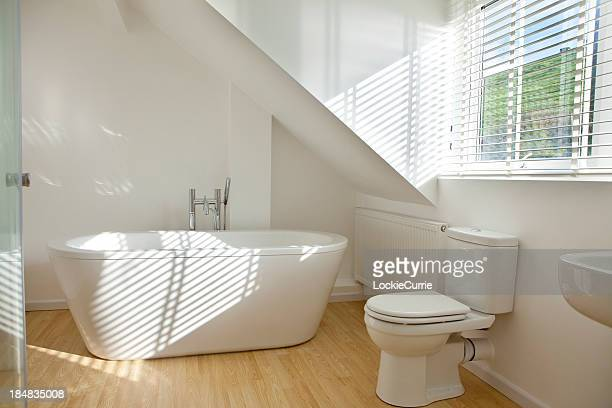 Modern white bathroom with toilet and sink