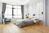 Modern white bed room ,king bed with black lamp and wood Bedside Tables  on  parquet flooring and white wall  ,3d rendering