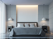 Modern white bedroom minimal style 3D rendering Image.There white empty wall.Decorate room with black grey white color and  hidden light on wall