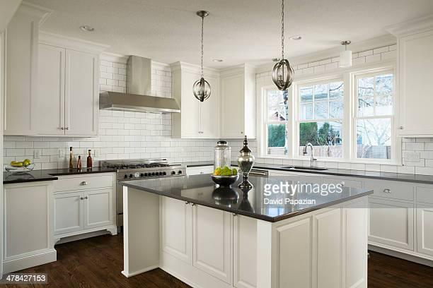 Modern white kitchen with lights off