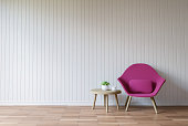 Modern white living room vintage style  3d rendering image.There are wood floor decorate wall with white wooden plank .Furnished with purple fabric armchair.