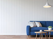 Modern white living room vintage style  3d rendering image.There are wood floor decorate wall with white wooden plank .Furnished with blue fabric sofa.