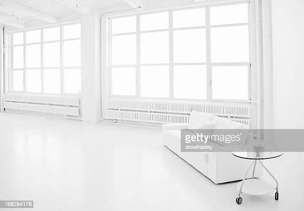 A modern, white loft living space