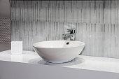 Modern white sink in bathroom interior close up view