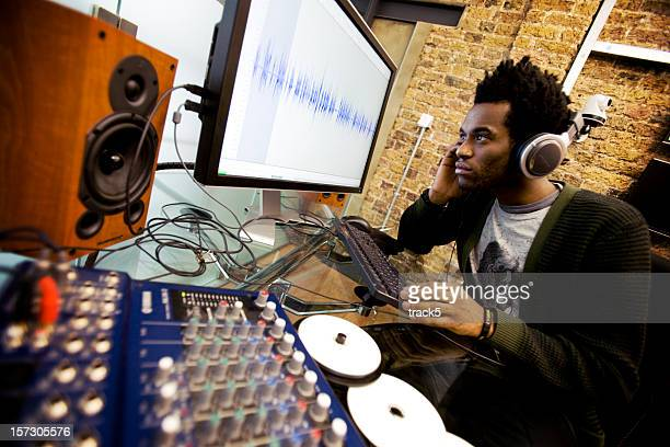 modern workplace: audio engineer working in his studio editing samples