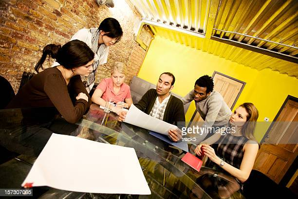 modern workplace: informal business meeting with diverse young creative professionals