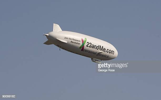 A modern Zeppelin airship floats across the downtown sky in this 2009 Healdsburg California afternoon summer photo