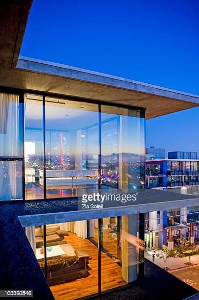 Modernist condo living room & bedroom, dusk