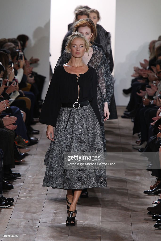 Modesl walk the runway during the Michael Kors fall 2014 fashion show on February 12, 2014 in New York City.
