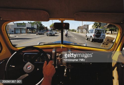 USA, CA, Modesto, man driving car in street, view from inside