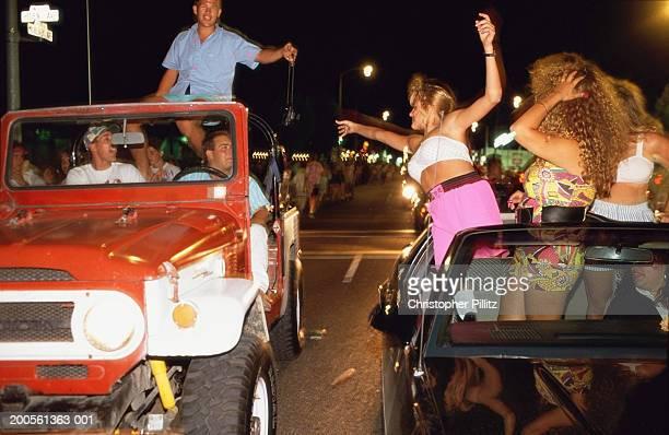 USA, CA, Modesto, people cruising in cars at night