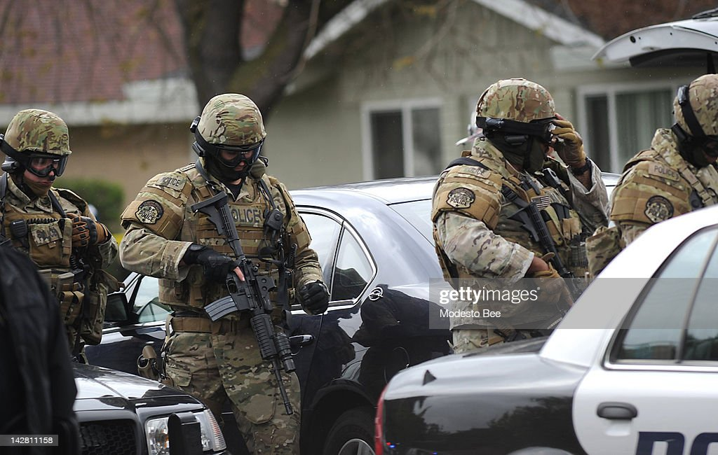 Modesto Police officers at the scene of an officer-involved shooting on Thursday, April 12, 2012, in Modesto California. A sheriff's deputy and another man were shot and killed in the incident.