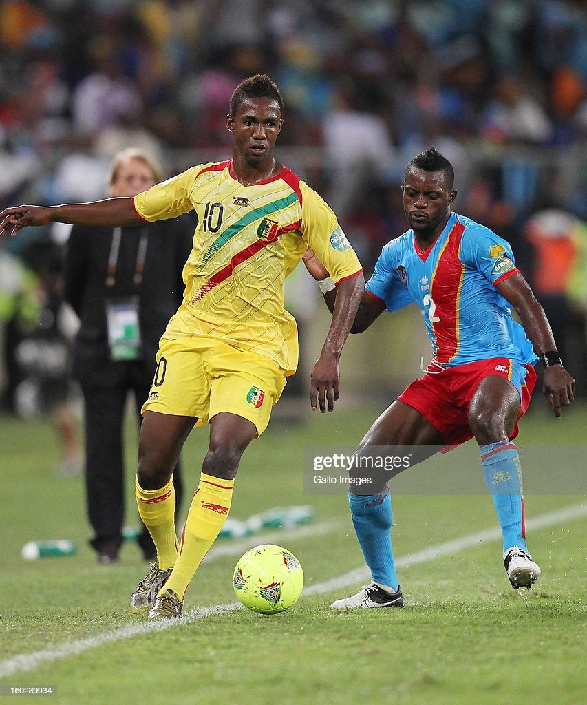 AFRICA - JANUARY 28, Modibo Maiga of Mali and Parfait Mandanda of DR Congo during the 2013 Orange African Cup of Nations match between DR Congo and Mali from Moses Mabhida Stadium on January 28, 2013 in Durban, South Africa.