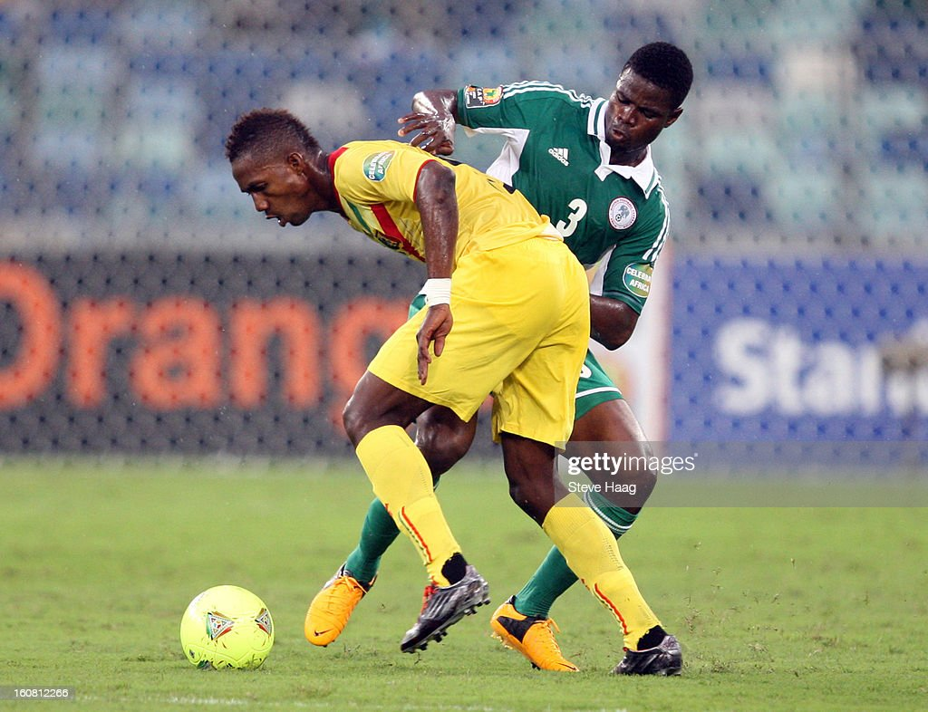 Modibo Maiga of Mali is tackled by Elderson Echiejile of Nigeria during the 2013 African Cup of Nations Semi-Final match between Mali and Nigeria at Moses Mahbida Stadium on February 06, 2013 in Durban, South Africa.