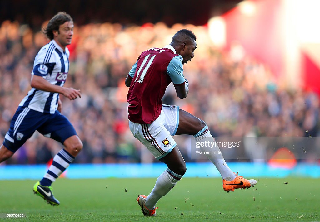 Modibo Maiga of West Ham scores their second goal during the Barclays Premier League match between West Ham United and West Bromwich Albion at Boleyn Ground on December 28, 2013 in London, England.