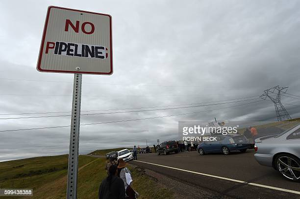 A modified highway sign reads 'No Pipeline' near the encampment where hundreds of people have gathered to join the Standing Rock Sioux Tribe's...
