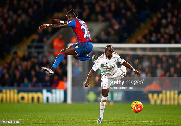 Modou Barrow of Swansea City and Pape N'Diaye Souare of Crystal Palace compete for the ball during the Barclays Premier League match between Crystal...