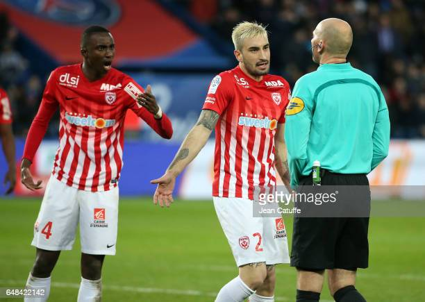 Modou Diagne and Erick Cabaco Almada of Nancy protest for the penalty against referee Antony Gautier during the French Ligue 1 match between Paris...