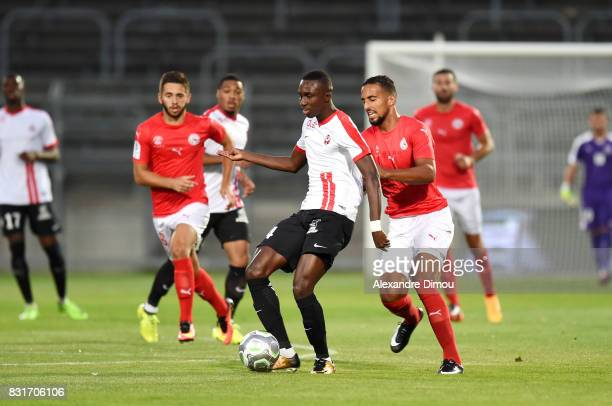 Modou Diagne of Nancy and Rachid Alioui of Nimes during the Ligue 2 match between Nimes Olympique and As Nancy Lorraine at Stade des Costieres on...