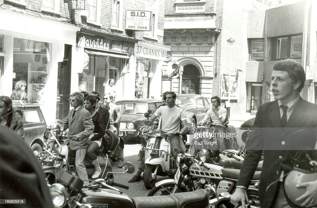 CONTENT] Mods on scooters in the Carnaby Street area of London being filmed for 'Steppin' Out', summer 1979. On the right-hand side of the photo is Mick Talbot of mod band The Merton Parkas. Talbot went on to play with The Style Council and Dexys.