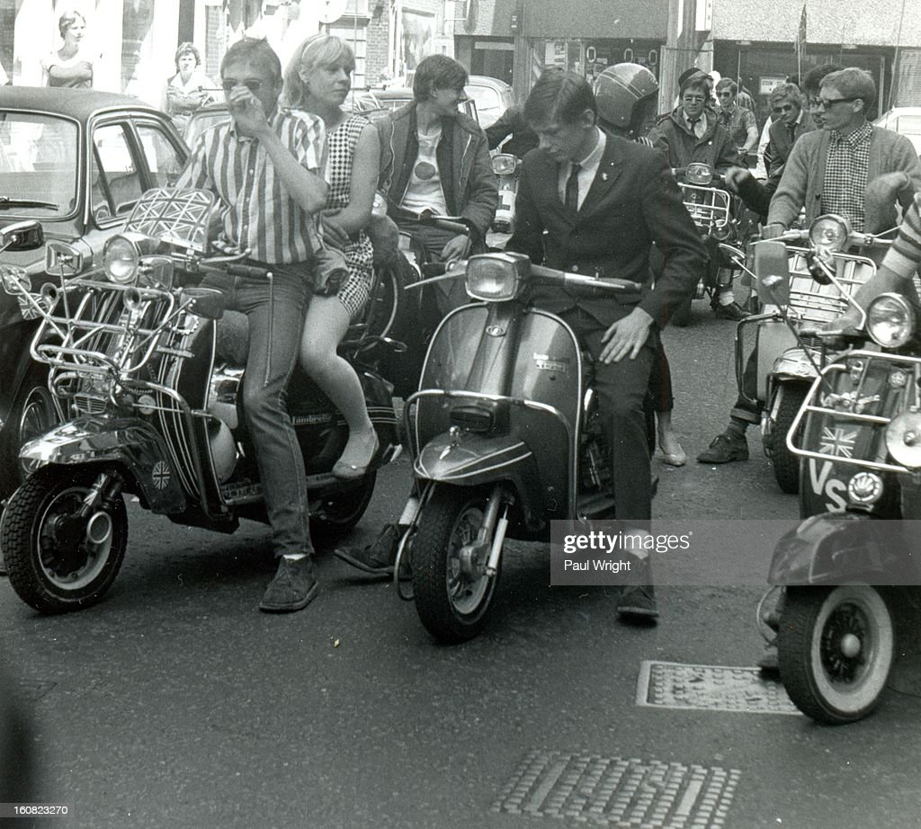 CONTENT] Mods on scooters in the Carnaby Street area of London filming 'Steppin' Out', summer 1979. 'Steppin' Out' is a short music documentary movie that was released in 1979. It was directed by Australian film director Lyndall Hobbs and was a survey of fashionable lifestyles in London which featured Secret Affair.