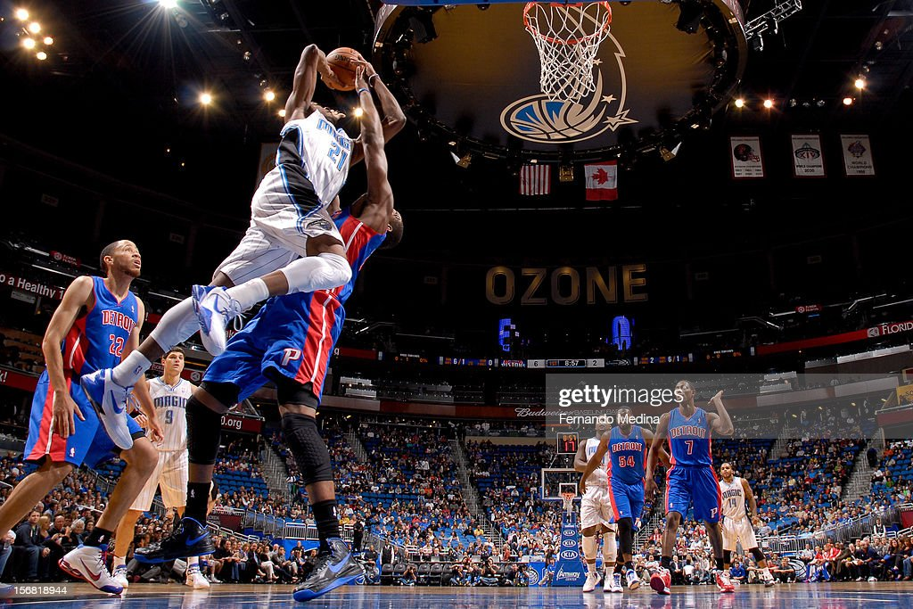 Moe Harkless #21 of the Orlando Magic drives to the basket against Greg Monroe #10 of the Detroit Pistons on November 21, 2012 at Amway Center in Orlando, Florida.