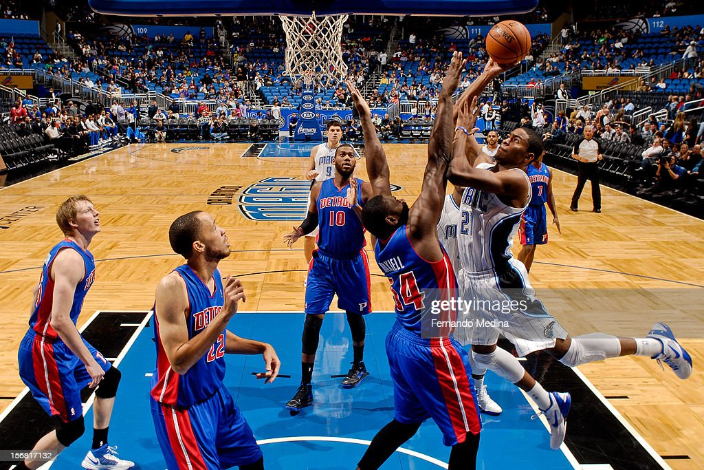 Moe Harkless #21 of the Orlando Magic drives to the basket against Jason Maxiell #54 of the Detroit Pistons on November 21, 2012 at Amway Center in Orlando, Florida.