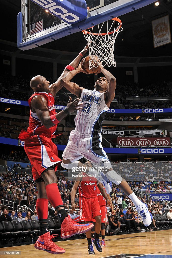 <a gi-track='captionPersonalityLinkClicked' href=/galleries/search?phrase=Moe+Harkless&family=editorial&specificpeople=8653497 ng-click='$event.stopPropagation()'>Moe Harkless</a> #21 of the Orlando Magic drives to the basket against <a gi-track='captionPersonalityLinkClicked' href=/galleries/search?phrase=Lamar+Odom&family=editorial&specificpeople=201519 ng-click='$event.stopPropagation()'>Lamar Odom</a> #7 of the Los Angeles Clippers on February 6, 2013 at Amway Center in Orlando, Florida.