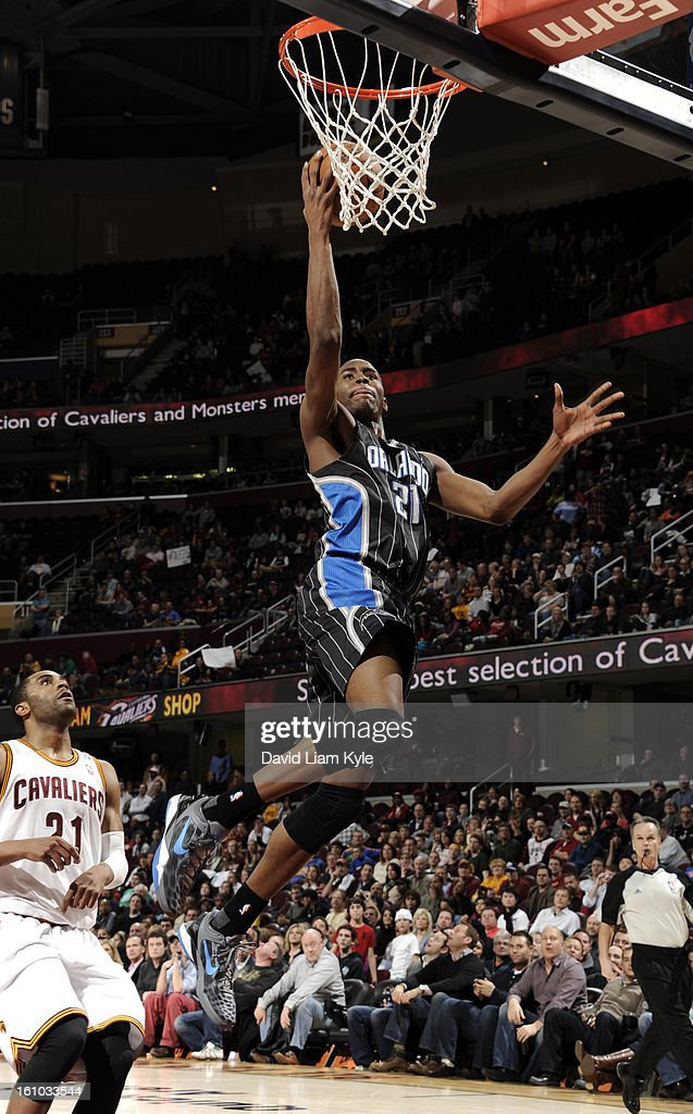 Moe Harkless #21 of the Orlando Magic goes up for the shot trailed by Wayne Ellington #21 of the Cleveland Cavaliers at The Quicken Loans Arena on February 8, 2013 in Cleveland, Ohio.