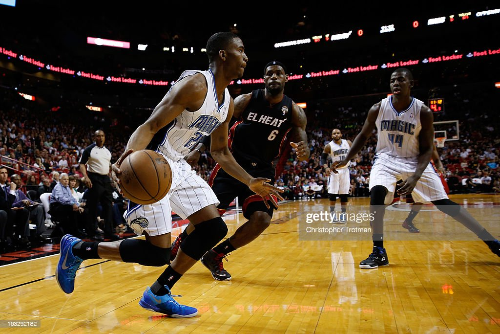 <a gi-track='captionPersonalityLinkClicked' href=/galleries/search?phrase=Moe+Harkless&family=editorial&specificpeople=8653497 ng-click='$event.stopPropagation()'>Moe Harkless</a> #21 of the Orlando Magic is guarded by <a gi-track='captionPersonalityLinkClicked' href=/galleries/search?phrase=LeBron+James&family=editorial&specificpeople=201474 ng-click='$event.stopPropagation()'>LeBron James</a> #6 of the Miami Heat at American Airlines Arena on March 6, 2013 in Miami, Florida.