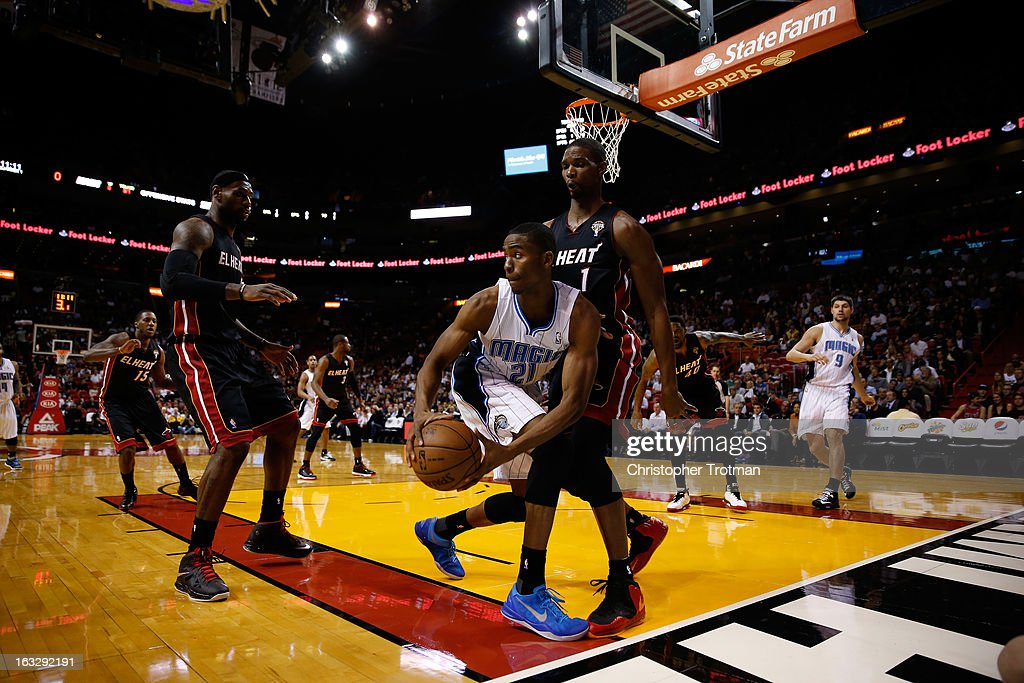 Moe Harkless #21 of the Orlando Magic is guarded by LeBron James #6 of the Miami Heat and Chris Bosh #1 of the Miami Heat at American Airlines Arena on March 6, 2013 in Miami, Florida.