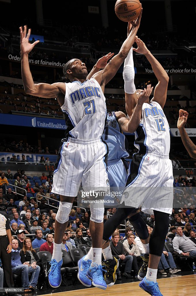 Moe Harkless #21 of the Orlando Magic rebounds against the Memphis Grizzlies on March 3, 2013 at Amway Center in Orlando, Florida.