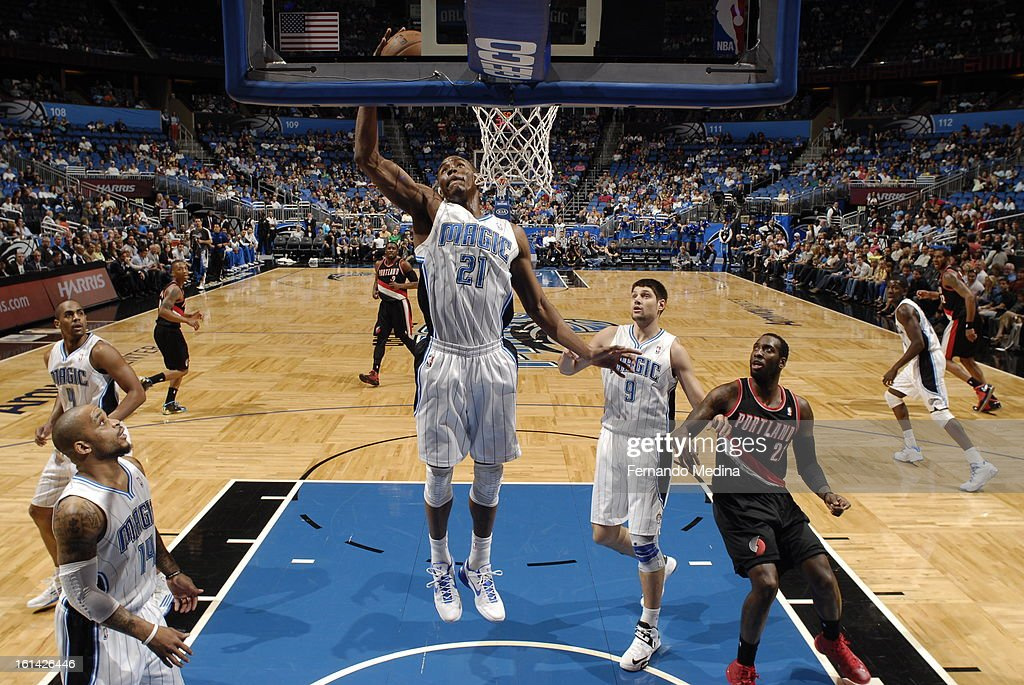 Moe Harkless #21 of the Orlando Magic rebounds against the Portland Trail Blazers on February 10, 2013 at Amway Center in Orlando, Florida.
