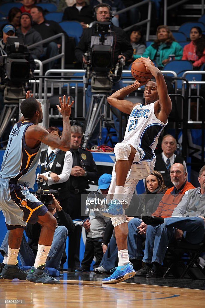 Moe Harkless #21 of the Orlando Magic saves the ball from going out of bounds against Tony Wroten #1 of the Memphis Grizzlies on March 3, 2013 at Amway Center in Orlando, Florida.