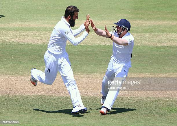 Moeen Ali and James Taylor celebrate AB de Villiers wicket during the day 5 of the 1st test match between South Africa and England at Sahara Stadium...