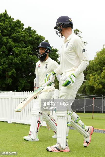 Moeen Ali and Keaton Jennings of England resume play after the lunch break during the Two Day tour match between the Cricket Australia CA XI and...
