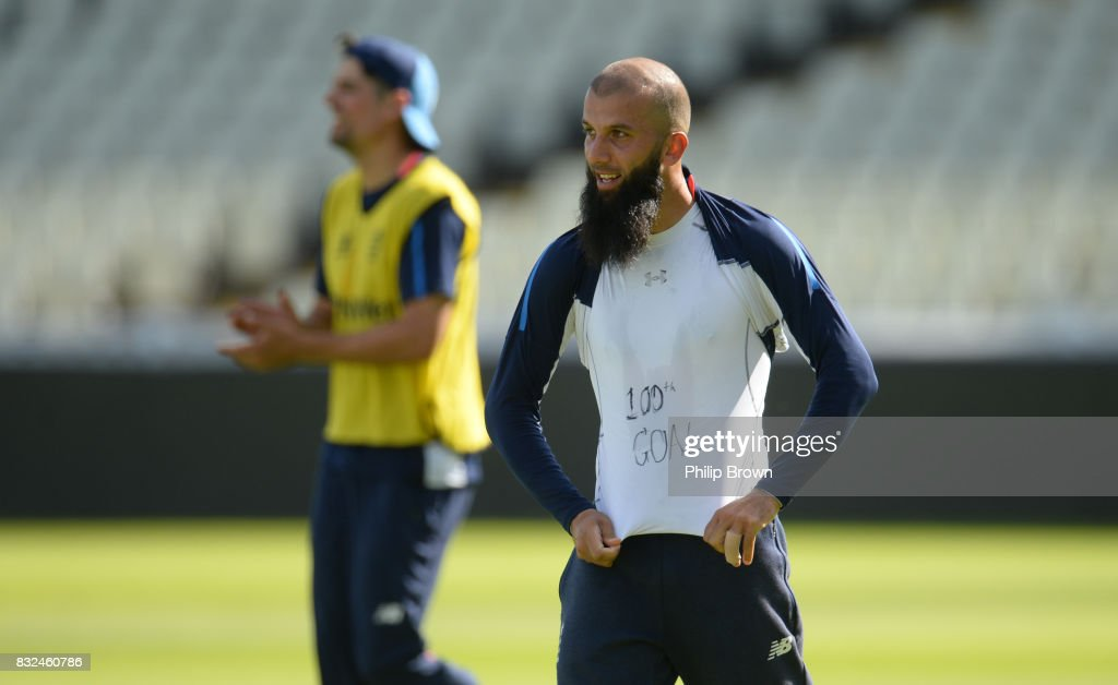 Moeen Ali lifts his shirt to show the words '100th goal' on another top after a goal during a training session before the 1st Investec Test match between England and the West Indies at Edgbaston cricket ground on August 16, 2017 in Birmingham, England.