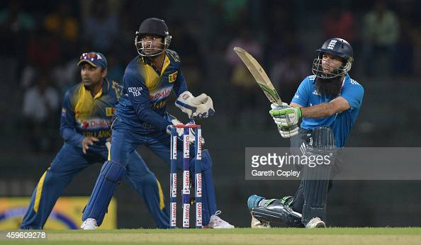 Moeen Ali of England bats watched by Kumar Sangakkara and Mahela Jayawardena of Sri Lanka during the 1st One Day International between Sri Lanka and...