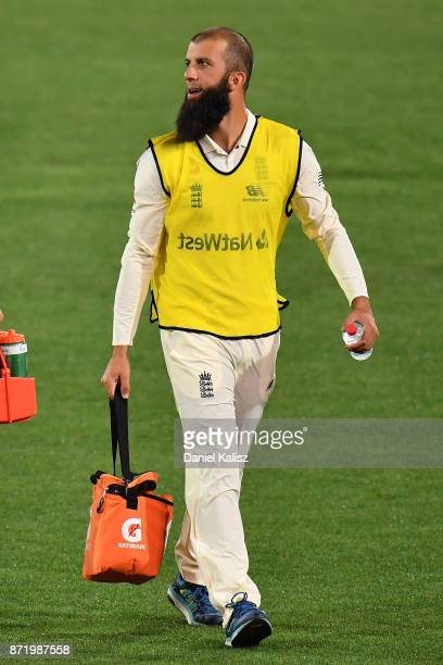 Moeen Ali of England carrys the drinks during day two of the Four Day Tour match between the Cricket Australia XI and England at Adelaide Oval on...