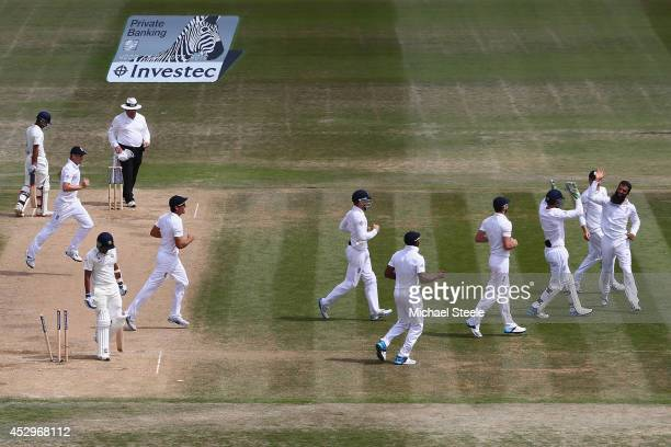 Moeen Ali of England celebrates bowling Mohammed Shami of India during day five of the 3rd Investec Test match between England and India at the Ageas...