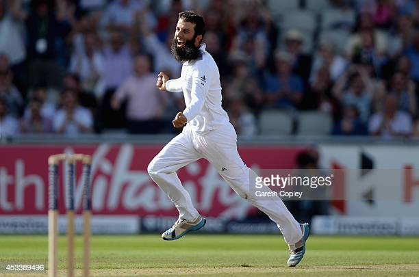 Moeen Ali of England celebrates dismissing Mahendra Singh Dhoni of India during day three of 4th Investec Test match between England and India at Old...