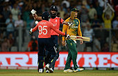 Moeen Ali of England celebrates hitting the winning runs with Adil Rashid to win the ICC World Twenty20 India 2016 Super 10s Group 1 match between...