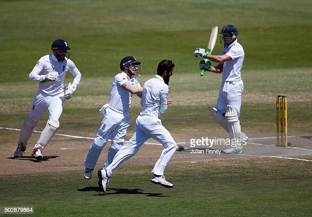 Moeen Ali of England celebrates taking the wicket of AB de Villiers of South Africa during day five of the 1st Test between South Africa and England...