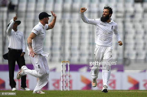 Moeen Ali of England celebrates with Ben Stokes after dismissing Bangladesh captain Mushfiqur Rahim during the first day of the 2nd Test match...