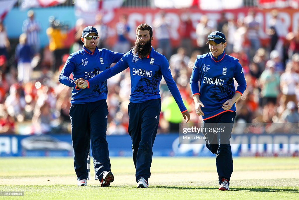 Moeen Ali of England celebrates with team mates after dismissing Kyle Coetzer of Scotland during the 2015 ICC Cricket World Cup match between England...