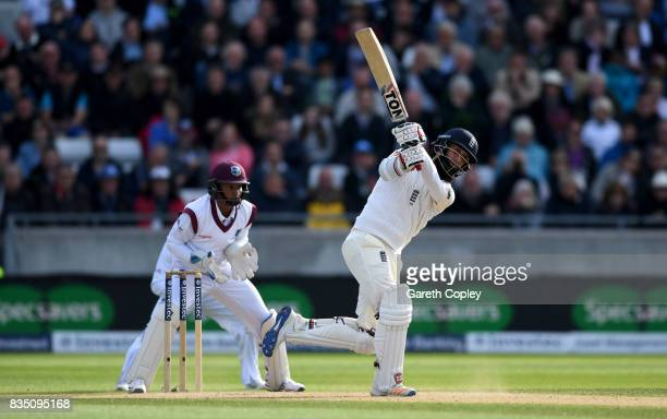 Moeen Ali of England hits out to be caught out by Kraigg Brathwaite of the West Indies during day two of the 1st Investec Test match between England...