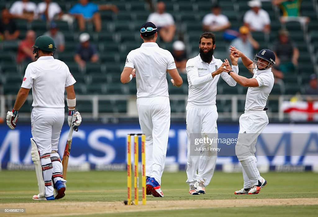<a gi-track='captionPersonalityLinkClicked' href=/galleries/search?phrase=Moeen+Ali&family=editorial&specificpeople=571813 ng-click='$event.stopPropagation()'>Moeen Ali</a> of England is congratulated after taking the wicket of <a gi-track='captionPersonalityLinkClicked' href=/galleries/search?phrase=Dean+Elgar&family=editorial&specificpeople=8593375 ng-click='$event.stopPropagation()'>Dean Elgar</a> of South Africa during day one of the 3rd Test at Wanderers Stadium on January 14, 2016 in Johannesburg, South Africa.