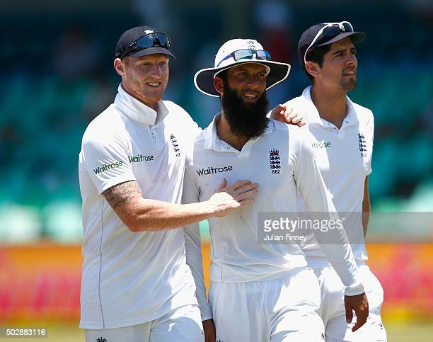 Moeen Ali of England is congratulated by Ben Stokes of England after their win by 241 runs during day five of the 1st Test between South Africa and...