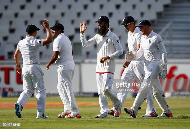 Moeen Ali of England is congratulated by team mates after catching out Dane Vilas of South Africa off Stuart Broad's bowling during day one of the...