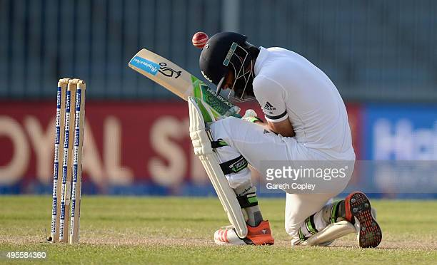 Moeen Ali of England is hit on the helmet by a ball from Wahab Riaz of Pakistan during day four of the 3rd Test between Pakistan and England at...